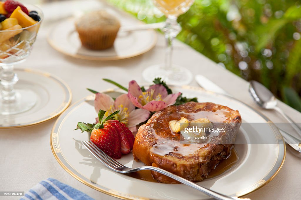 French toast with strawberries and bananas : Stock Photo