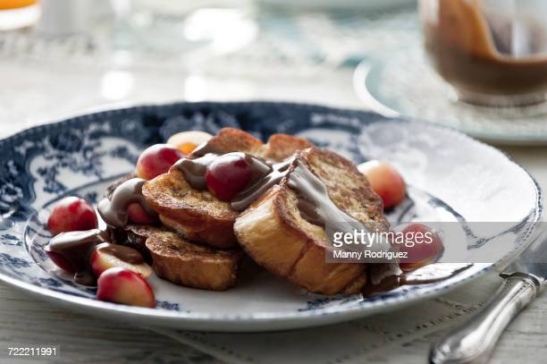 French toast with syrup and cherries