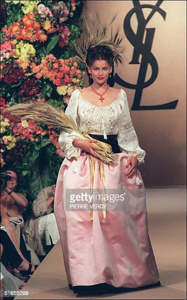 French topmodel Laetitia Casta presents a wedding dress for Yves SaintLaurent during the AutumnWinter 1999/2000 haute couture collections in Paris 21...