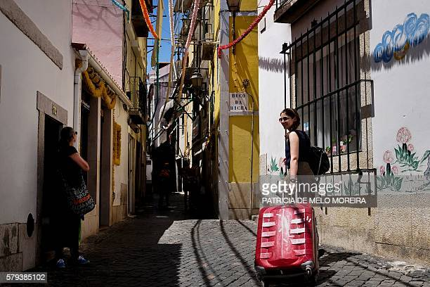French tourist Murielle Sbai and her daughter Zahra Sbai arrive at Alfama neighborhood in Lisbon on June 29 2016 The popular and most emblematic...