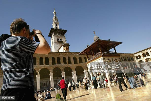 French tourist takes pictures inside the 8th century Umayyad Mosque April 17 2005 in Damascus Syria Despite American threats and the chaos engulfing...