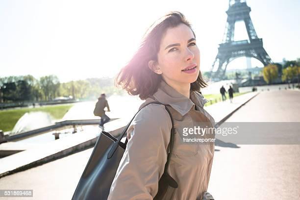 french tourist woman walking in paris