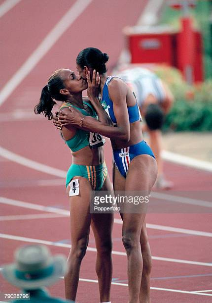 French track and field athlete MarieJose Perec is congratulated by Australian silver medallist Cathy Freeman after crossing the finish line in first...