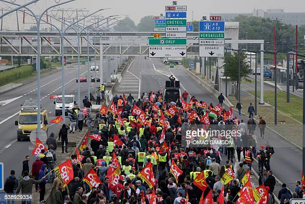 French trade union CGT and Communist Youth militants demonstrate on the road near the Rungis International Food Market in Rungis south of Paris early...