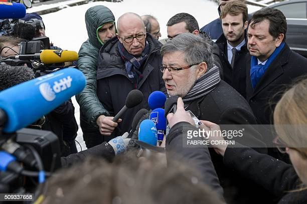 French Transport Minister Alain Vidalies answers journalists' questions on February 10 in Montbenoit near Pontarlier eastern France after a school...