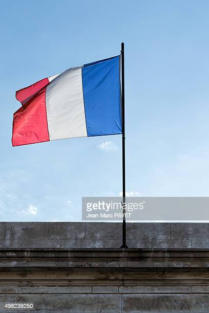 french tricolor flag floating in a blue sky - jean marc payet stock pictures, royalty-free photos & images