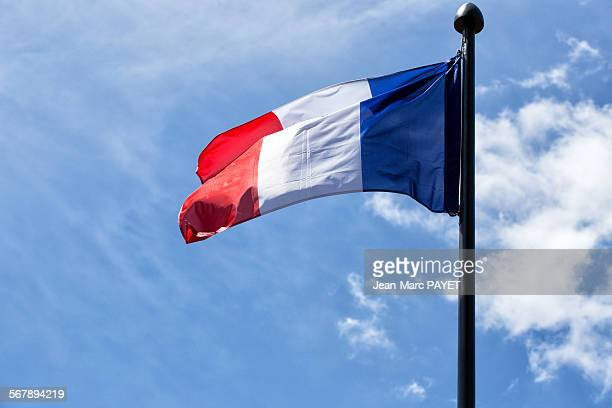 french tricolor flag floating in a blue sky - jean marc payet stockfoto's en -beelden