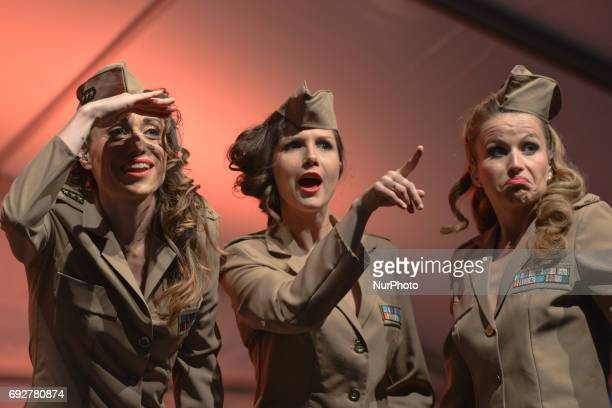 French trio 'Girly Swing' dressed in US ARmy 1944 uniforms perform in front of crowd in Arromanches during D-Day Festival Normandy 2017. Tuesday 6th...