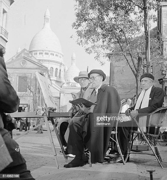 Noted French motion picture actordirectorwriter Sacha Guitry now filming the story of Paris watches famous painter Maurice Utrillo at a canvas in...