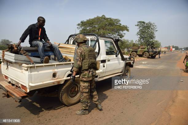 French troops from the Operation Sangaris forces check traffic, looking for weapons, on January 9, 2014 in the fourth district of Bangui . Central...