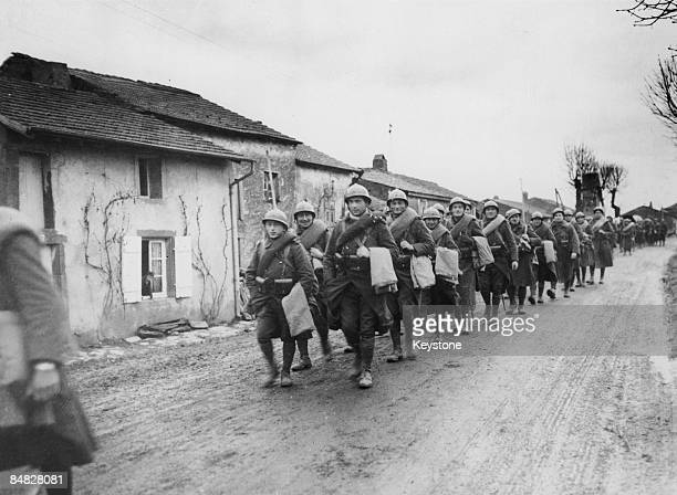 French troops marching through a village on their way to the Western Front 9th December 1939