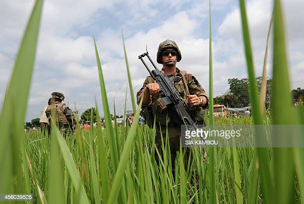 French troops of operation Sangaris guard the distribution of food by the World Food Programme to refugees from the fighting near Bangui airport on...