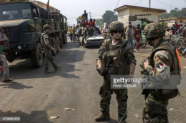 French troops of the 'Operation Sangaris' take position at a checkpoint in Bangui's PK12 area Central African Republic on February 18 2014 Eight...