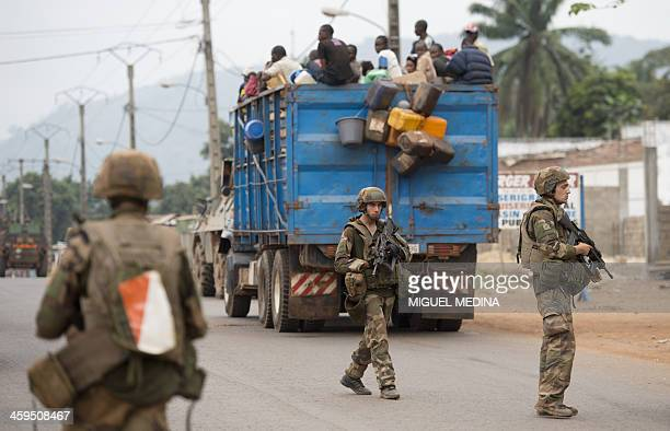 French troops of the Sangaris military operation stand guard as they secure the Gobongo district of Bangui on December 27 2013 French troops were out...