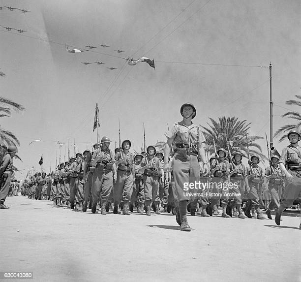 French Troops Passing Reviewing Stand in Allied Victory Parade along Avenue Gambetta as American Planes Fly Overhead in Show of Allied Might Tunis...