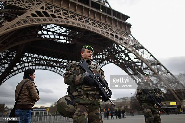 French troops patrol around the Eifel Tower on January 12, 2015 in Paris, France. France is set to deploy 10,000 troops to boost security following...