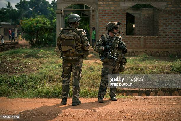 French troops patrol in the streets of the Galabadja neighborhood in Bangui on December 14 2013 as part of operation Sangaris France raised alarm on...
