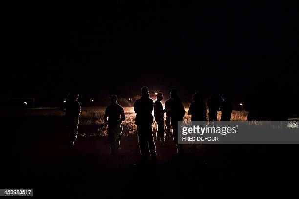 French troops taking part in operation Sangaris wait at a base camp on December 6 2013 in Cameroon on the border of the Central African Republic...