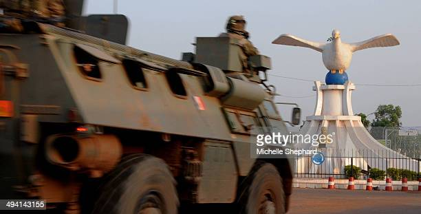 REPUBLIC French troops who are part of a mission known as Sangaris approach a roundabout at the capital's Place de la Reconciliation