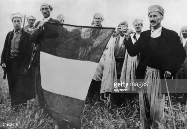 French troops with a recaptured tricolour during the Algerian War of Independence 1956