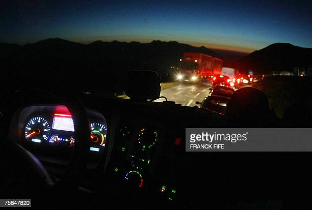 French truck driver Gilles Houte, working for JFC production company, is caught in a thick traffic jam while descending The Col d'Aubisque after the...