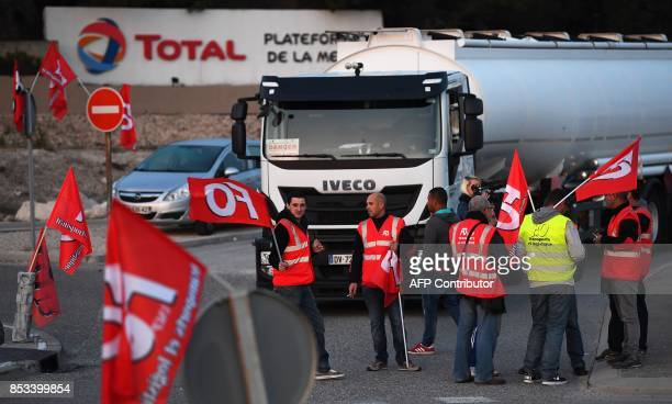 French truck drivers block the access to the Total refinery to protest against the French labour law reform on September 25, 2017 in La Mede, near...
