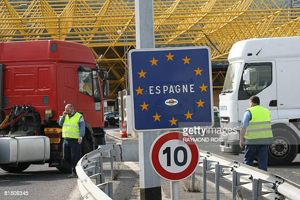 French truck drivers block the Perthus border crossing at the Spanish border on June 9 to protest against the governement's measures over soaring...