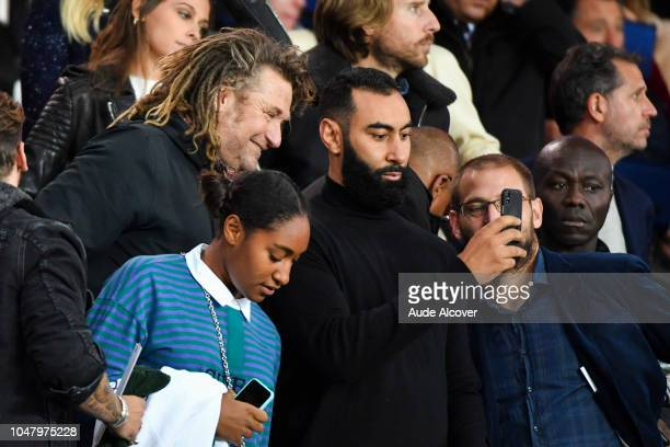French tv and radio presenter Olivier Delacroix and rapper La Fouine during the Ligue 1 match between Paris Saint Germain and Lyon at Parc des...