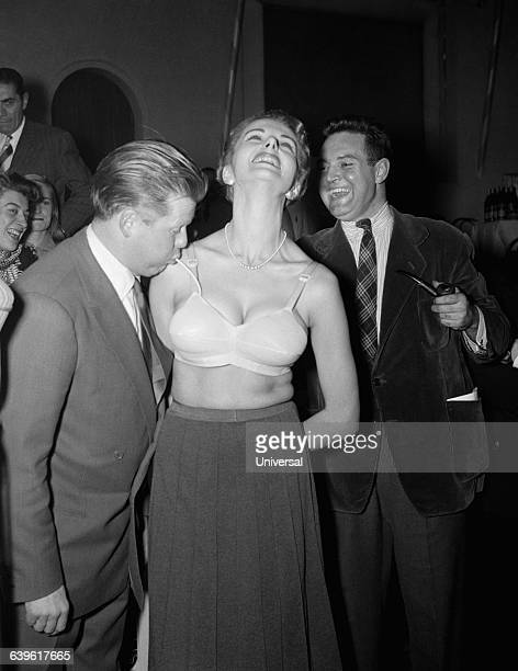 French TV celebrity Jacques Angelvin shows the new inflatable pushup bra for the first time in France Angelvin was later arrested for drug trafficking