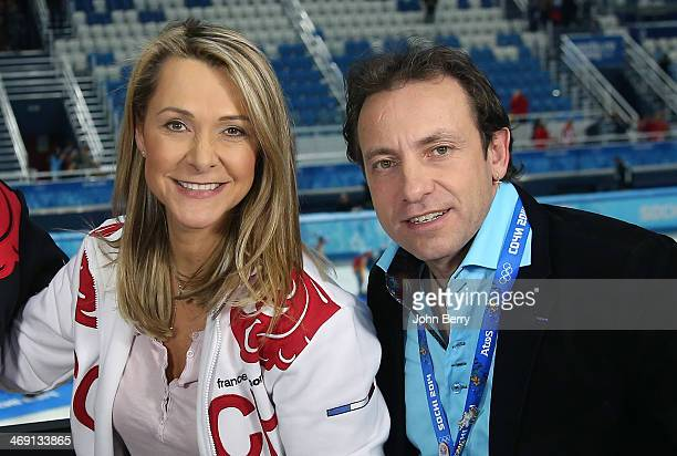 French TV commentators Annick Dumont and Philippe Candeloro pose during the Figure Skating Pairs Free Program on day 5 of the Sochi 2014 Winter...