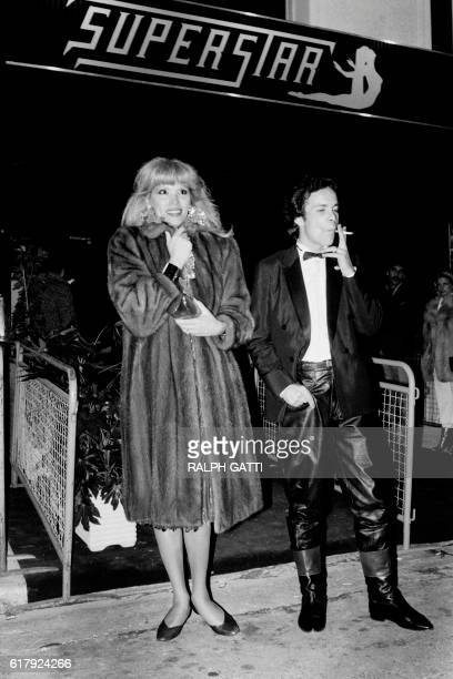 French TV host and singer Amanda Lear and her husband AlainPhilippe Malagnac leave the Superstar night club during the Italian Film Festival on...