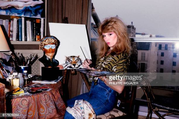 French TV host and singer Amanda Lear poses in her studio on December 16 in Paris.