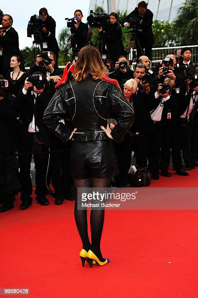 French TV host Daphne Burki arrives with red high heel shoes attached to her jacket attends the You Will Meet A Tall Dark Stranger Premiere at the...
