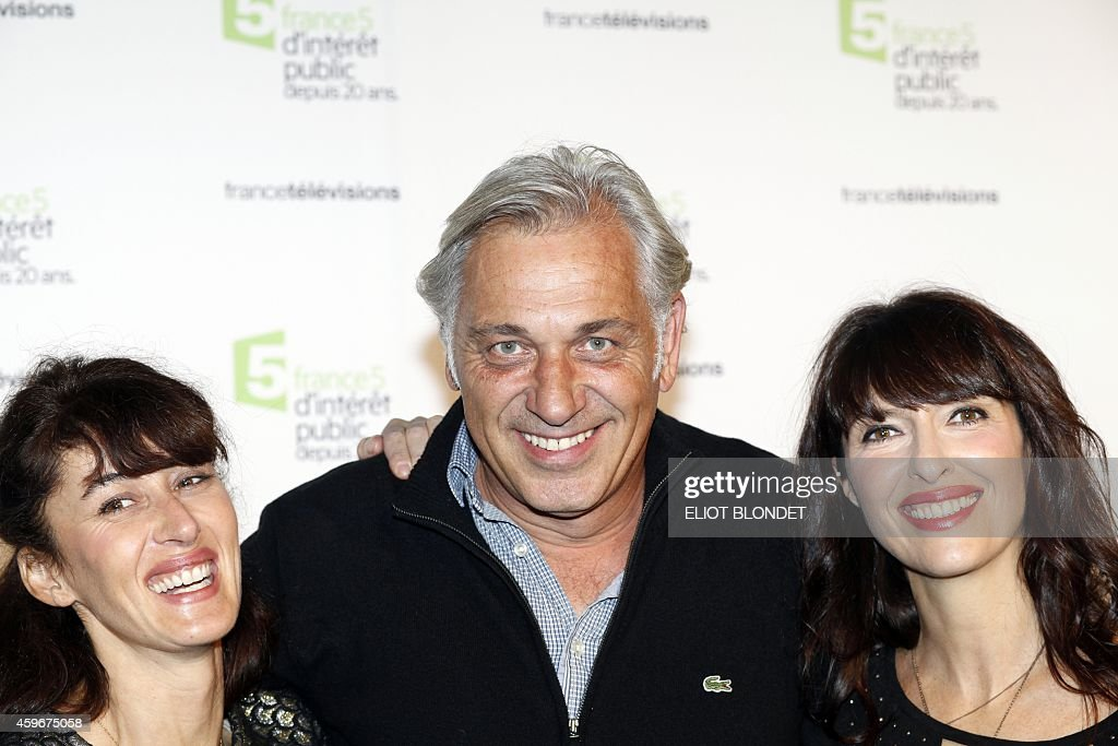 French TV host Gaelle Cuisy (L) and Karine Martin pose with Stephane ...