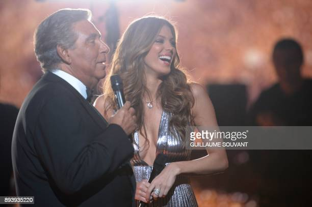 French TV host JeanPierre Foucault and Miss France 2016 Miss Universe 2016 and president of the jury Iris Mittenaere attend the Miss France 2018...
