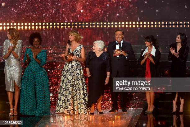 French TV host JeanPierre Foucault and Miss France Organisation Director and Miss France 2002 Sylvie Tellier present the members of the jury Miss...