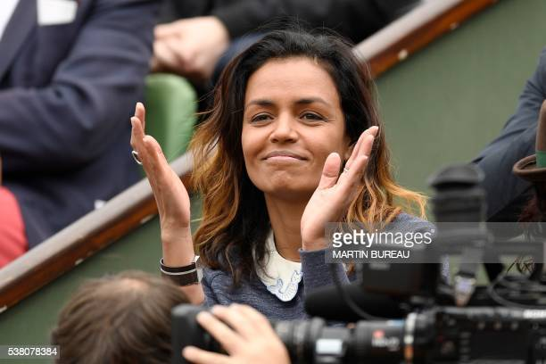 French TV host Laurence Roustandjee attends the women's final match between Spain's Garbine Muguruza and the US's Serena Williams at the Roland...