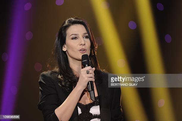 French TV host Marie Drucker presents the 26th Victoires de la Musique yearly French music awards ceremony on March 1 2011 at the Palais des Congres...