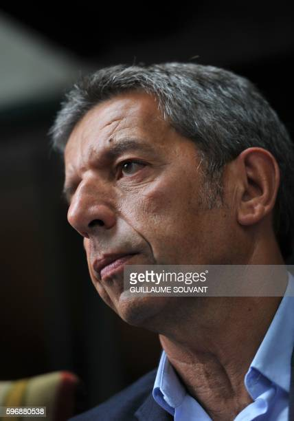 French TV host Michel Cymes looks on on August 28 2016 in ChanceauxprèsLoches central France during the 21th book fair 'The book forest' / AFP /...