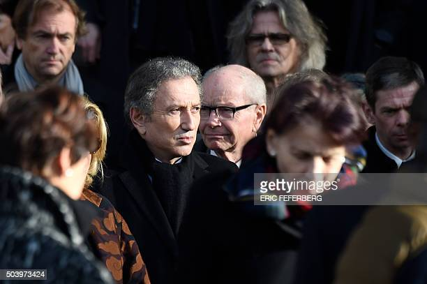 French TV host Michel Drucker leaves after attending the funeral ceremony of late French singer Michel Delpech on January 8 2016 at SaintSulpice...