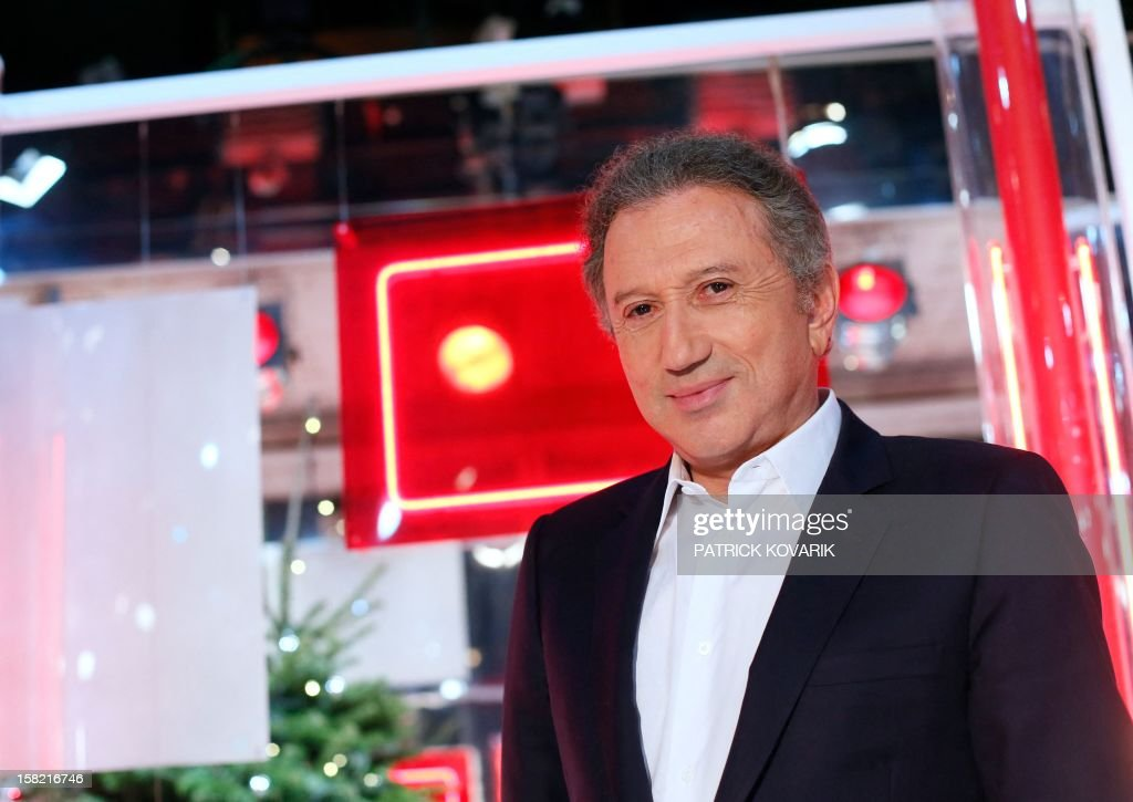 French TV host Michel Drucker poses on the set of the French TV France 2 show, 'Vivement Dimanche', on December 11, 2012 in Paris.