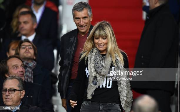 French TV host Nagui and his wife Melanie Page attend the French Ligue 1 football match between Paris SaintGermain and Lyon at the Parc des Princes...