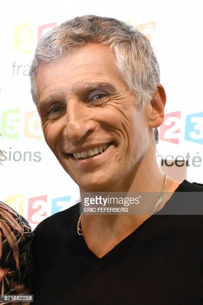 French TV host Nagui poses during a photocall for the 31st edition of the French Telethon fundraising event on November 8 in Paris / AFP PHOTO / Eric...