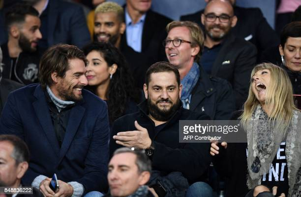 French tv host Nagui's wife Melanie Page jokes with French Camille Lacourt during the French Ligue 1 football match between Paris SaintGermain and...