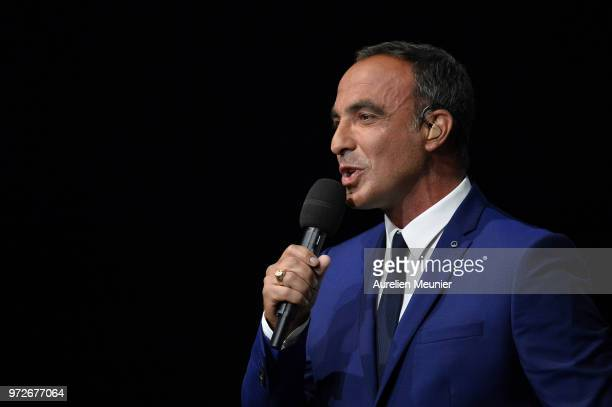 French tv host Nikos Aliagas speaks on tv during the players presentation before the friendly match between France 98 and FIFA 98 at U Arena on June...