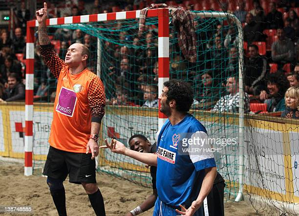 French Tv host Vincent Lagaff gestures near French humorist Ramzi and French actor David Baiot during a charity beach soccer match on February 11...
