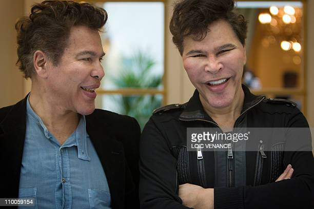 French TV hosts Igor and Grichka Bogdanov pose prior to take part in a lunch gathering French most read writers in 2010 on March 8 2011 in Paris AFP...