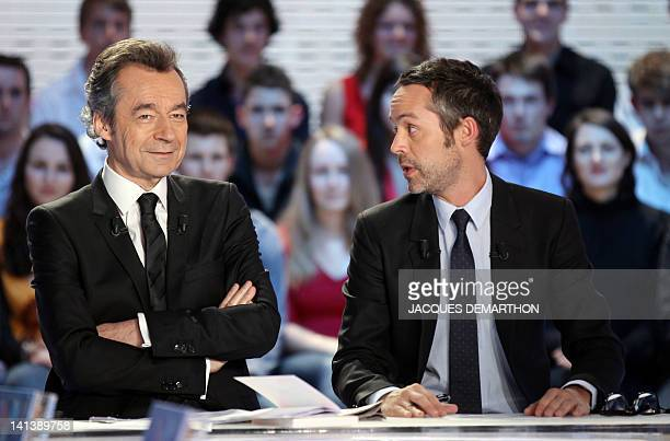 French TV hosts Yann Barthès and Michel Denisot pose prior to take part in his TV show 'Le grand journal' on a set of French TV Canal on March 15...