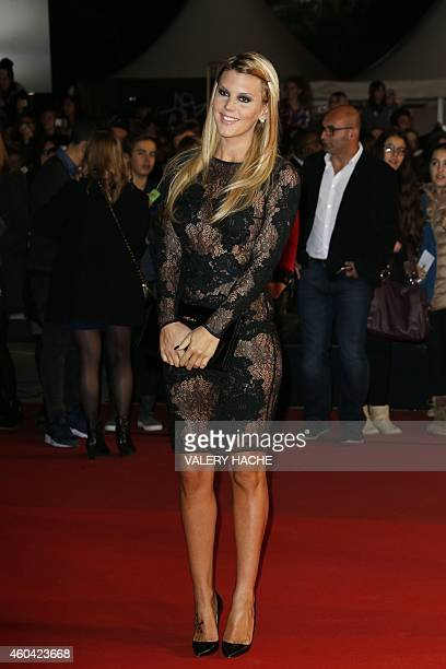 French TV personality Amelie Neten poses upon her arrival at the Palais des Festivals to attend the 16th Annual NRJ Music Awards on December 13 2014...