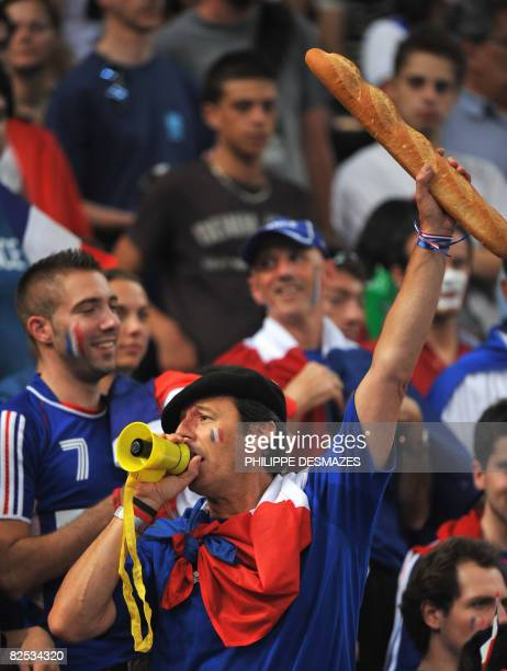 French TV presenter Jean-Luc Reichman cheers during the men's handball gold medal match of the 2008 Beijing Olympic Games between France and Iceland...
